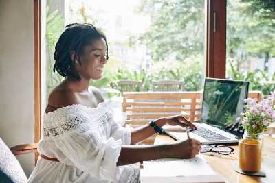 Lady remotely working from home on her laptop